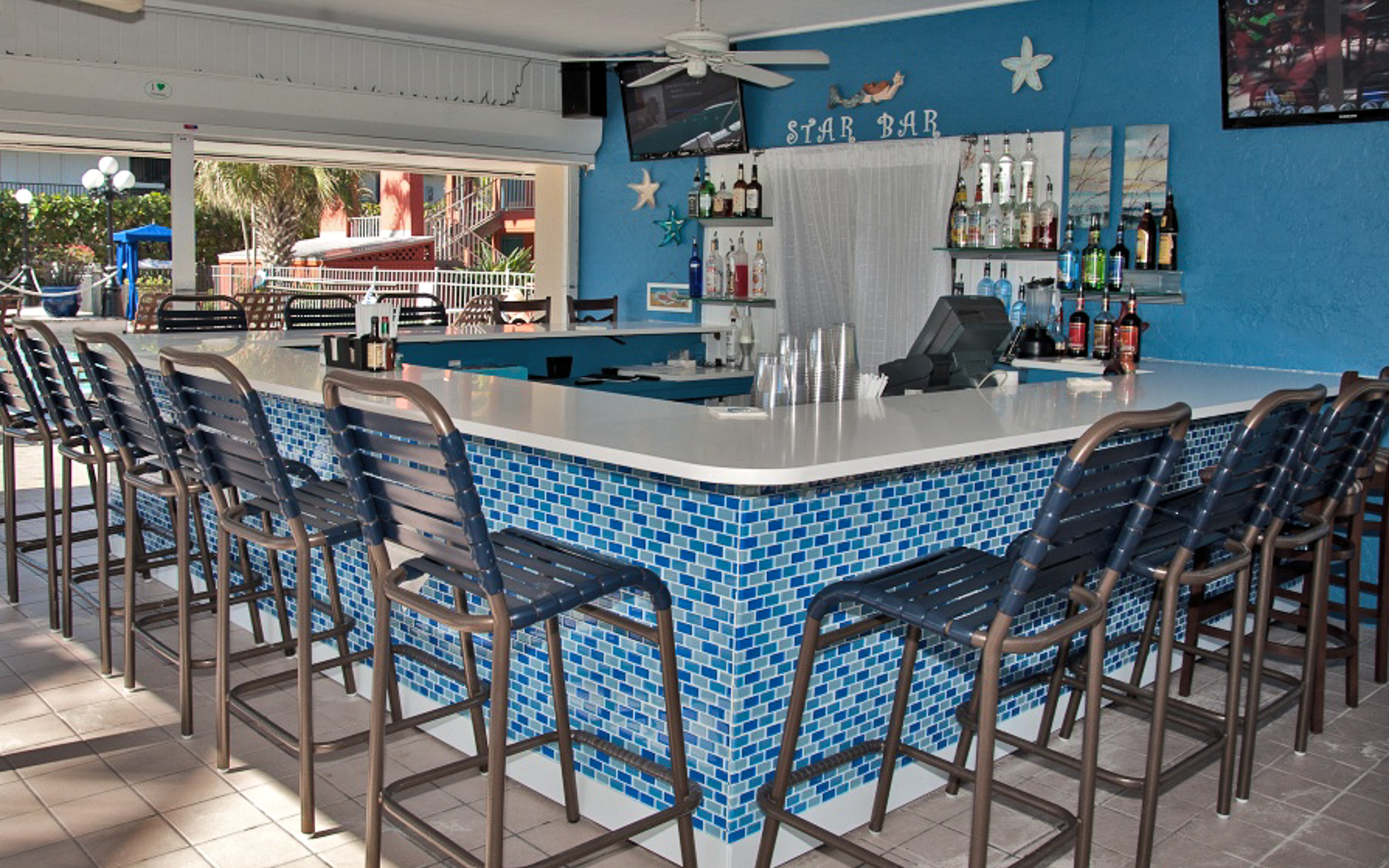 Bar area in blue tones with tall chairs