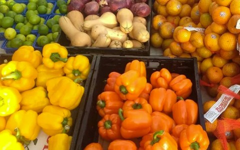 Colorful vegetables in bins at farmers market