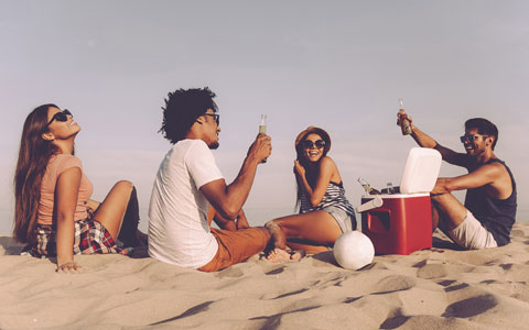 Friends drinking on the beach