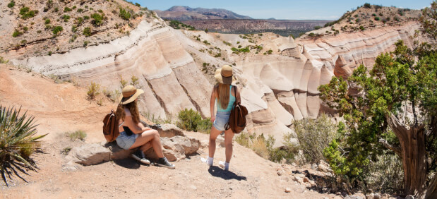 two girls hiking canyons in new mexico