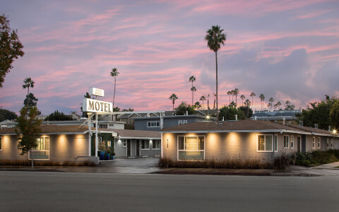 Motel exterior with pink sky sunset