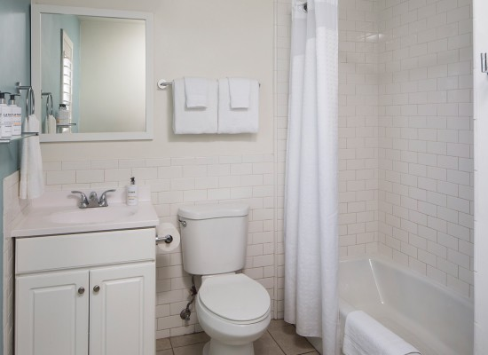 Guest bathroom with white subway tile and blue wall