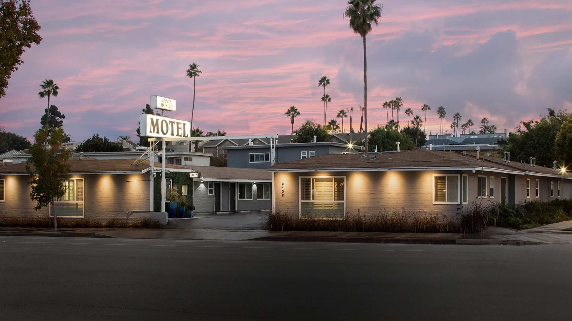 motel exterior with pink sky at sunset