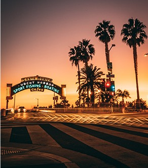 Santa Monica pier sign at sunset