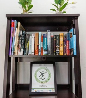 Wooden bookshelf with green certificate award