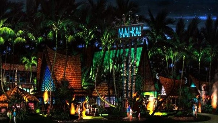Restaurant lit up at night with palm trees