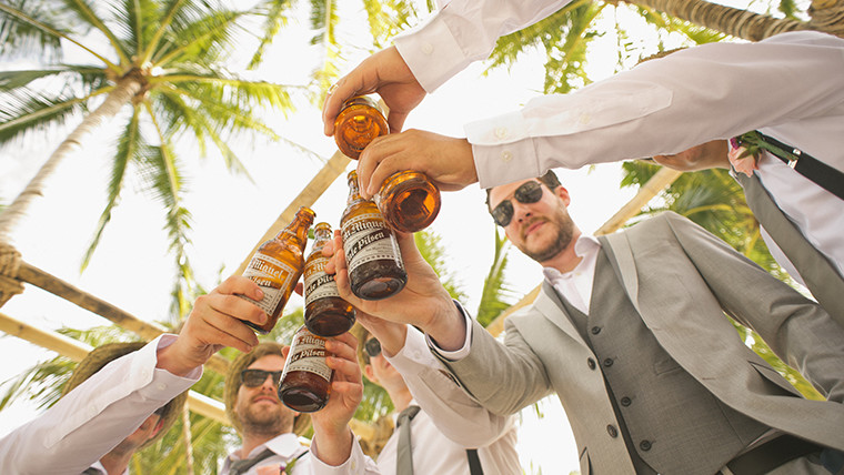 Groomsmen Toasting Under Palm Trees