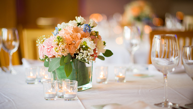 Elegant Wedding Table Setting with pastel flower arrangements