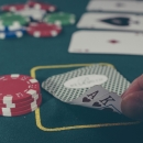 cards and chips on a poker table in a casino