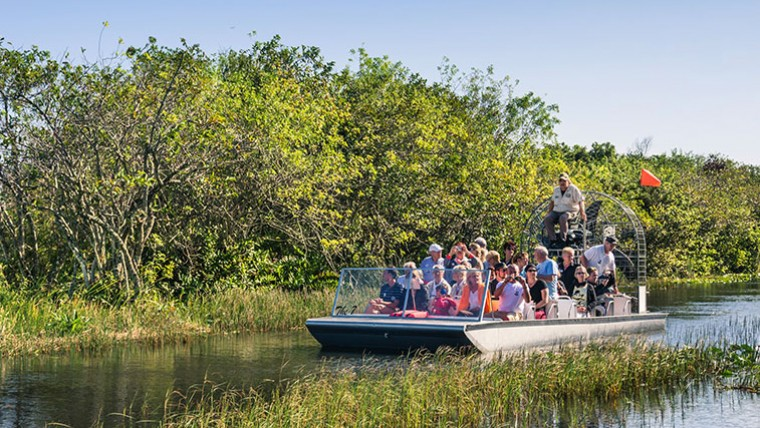 Group of people taking a tour on an airboat