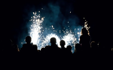 people in front of a fireworks