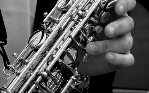 Close up of person playing sax