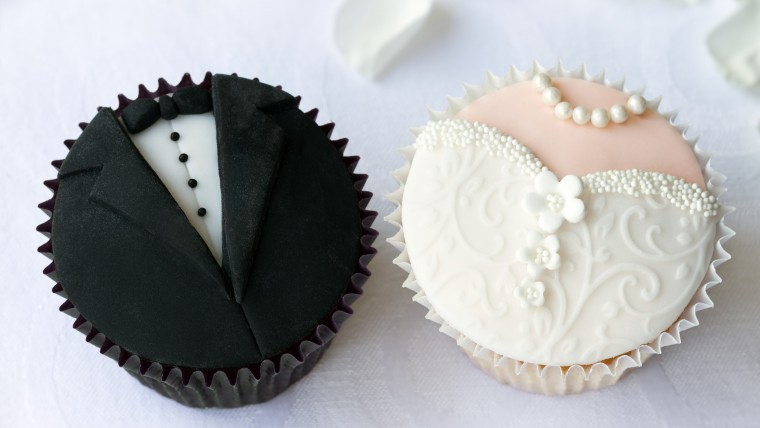 Cupcakes with with groom & bride sugar decor