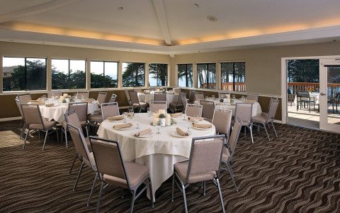 Event space set up with round tables and white table clothes