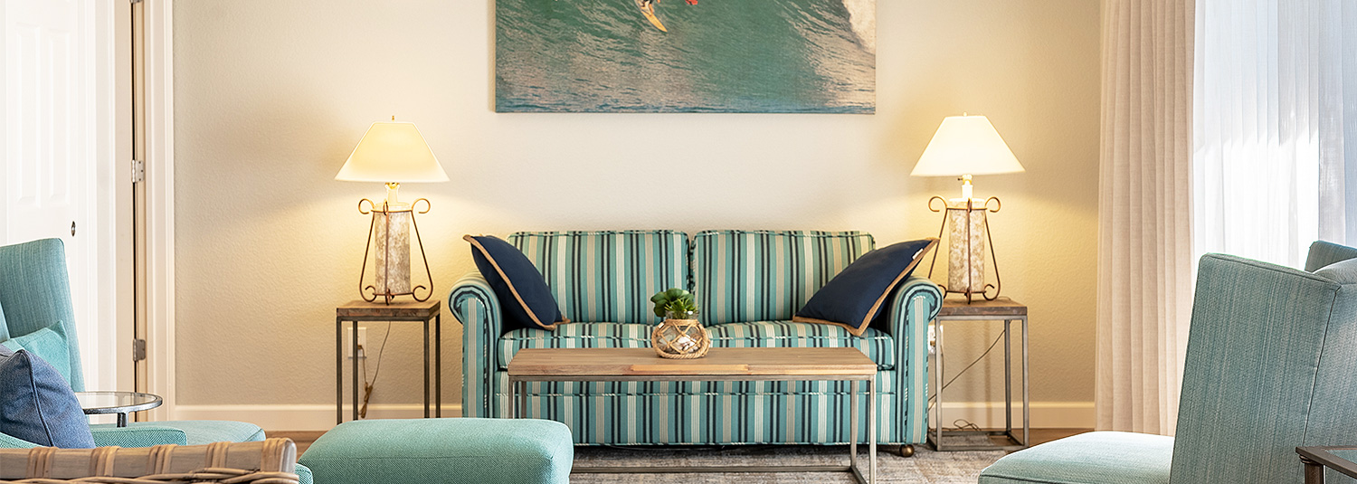 Striped aqua sofa with wooden coffee table