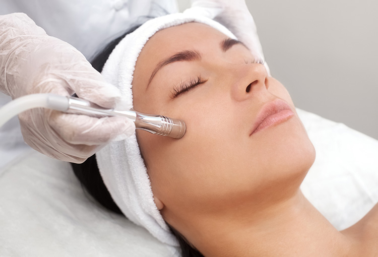 Woman laying down at spa getting microdermabrasion