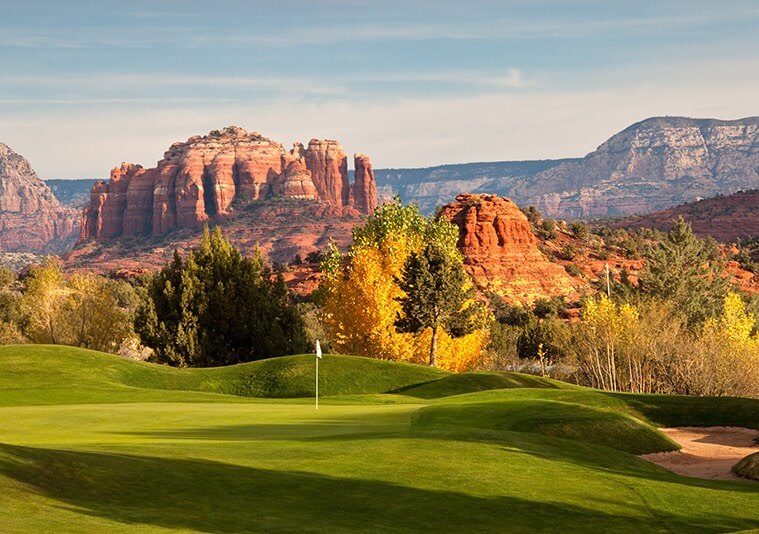 rock formations in sedona on a golf course