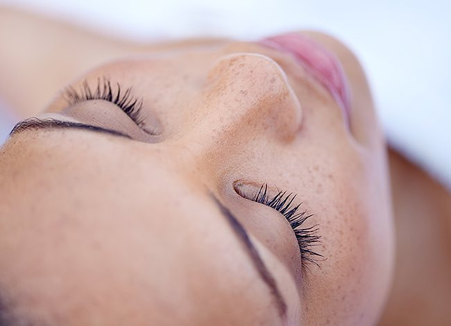 a woman with her eyes closed at the spa