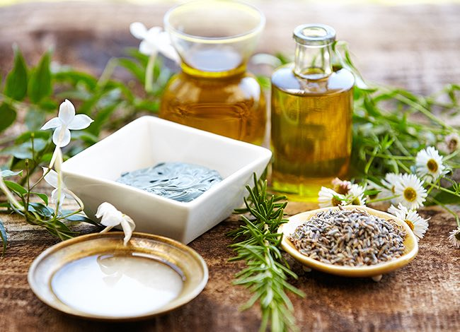 Spa treatment creams and ingredients in bowls