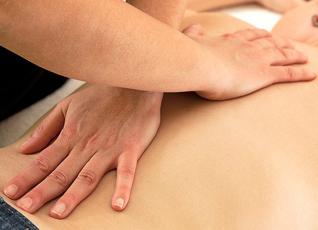 a woman's hands giving a massage
