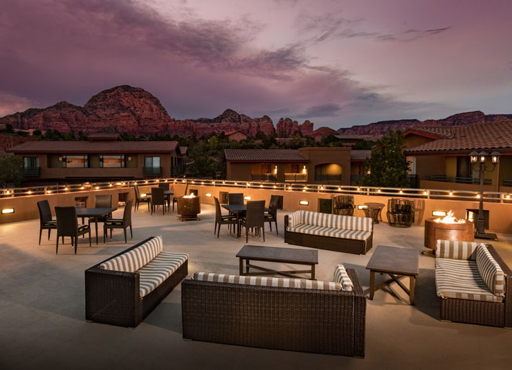 rooftop patio with lunge chairs and firepits sedona at a galnce gallery