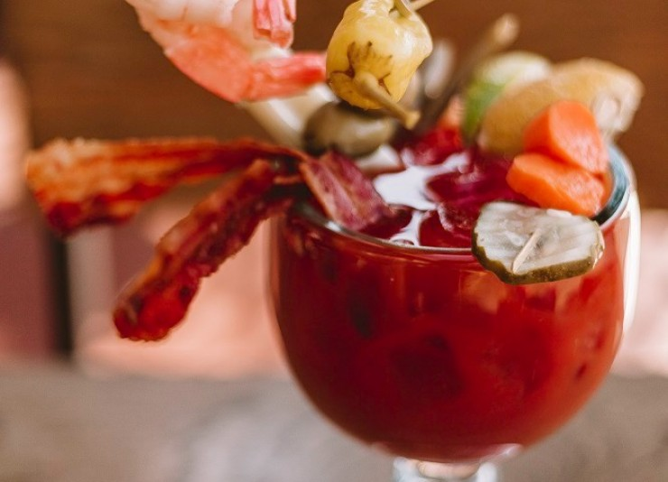 Bloody Mary cocktail with shrimp and bacon