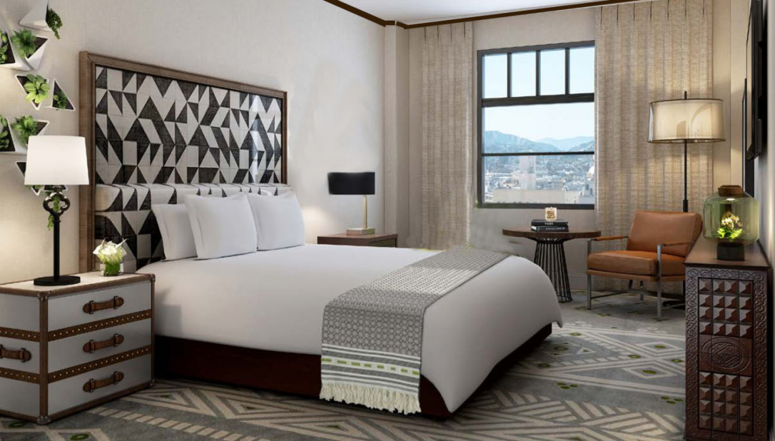 room with white bed with geometric black and white headboard and window