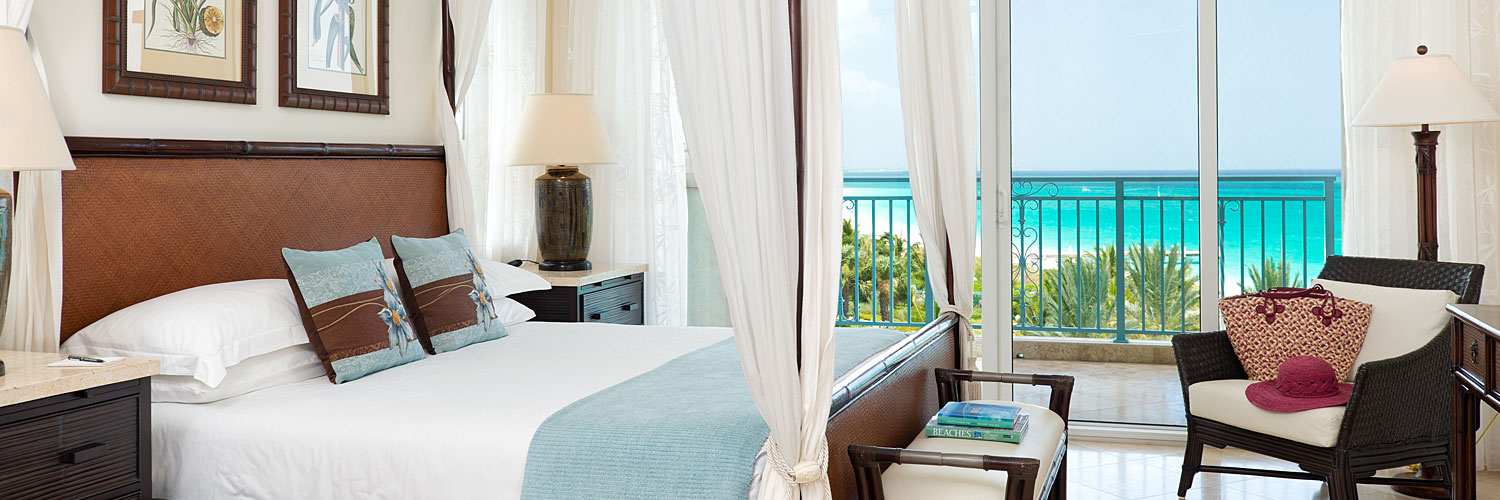 Guest room with canopy bed and oceanview