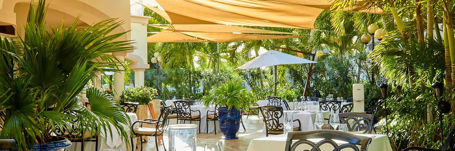 Outdoor dining area under yellow awnings