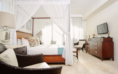 Guest room with canopy bed and sitting area