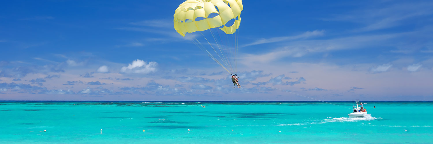 Boat pulling parasailer in the ocean
