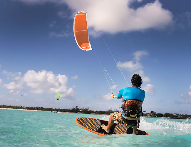 Man Kiteboarding on ocean