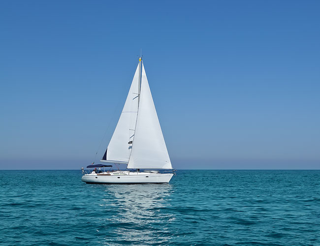 White sailboat on ocean