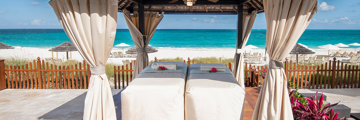 beachside cabana with two massage tables