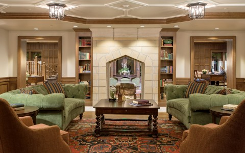 Lobby with sofas and wooden bookshelves