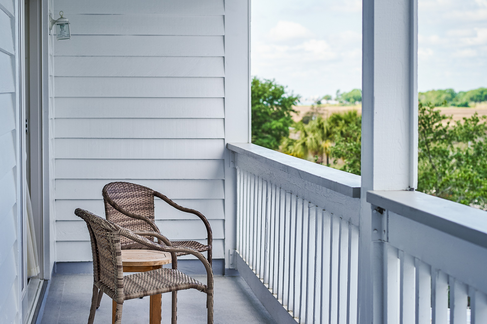 chairs on patio of room overlooking the creek