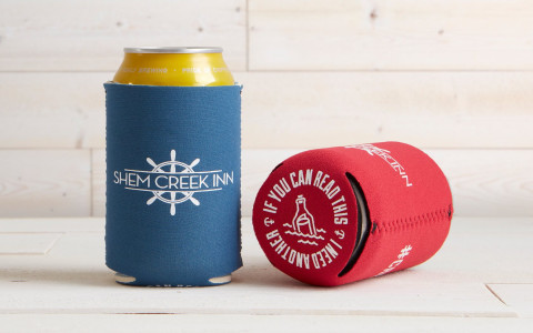 beer cans with shem creek koozie