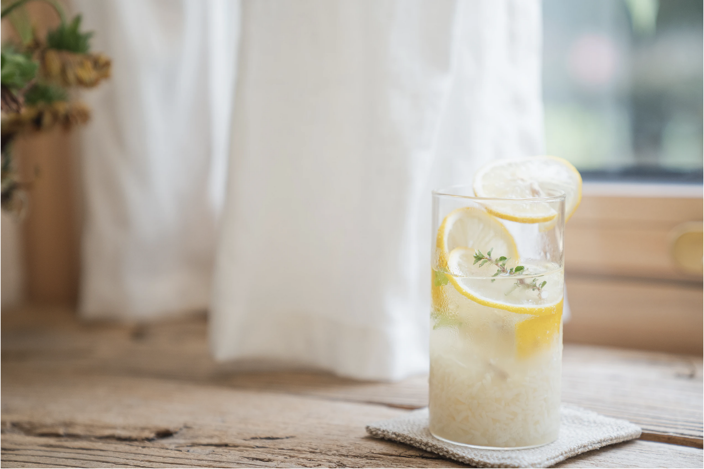 photo of lemonade in a glass on a window sill