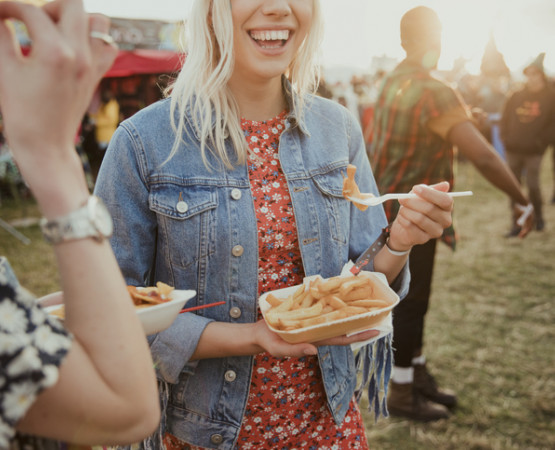 girls eating food at a festival
