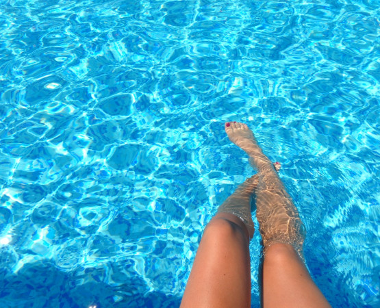 legs in pool water