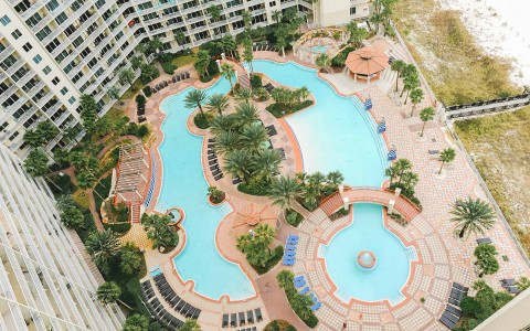 an aerial shot of the lazy river and pool