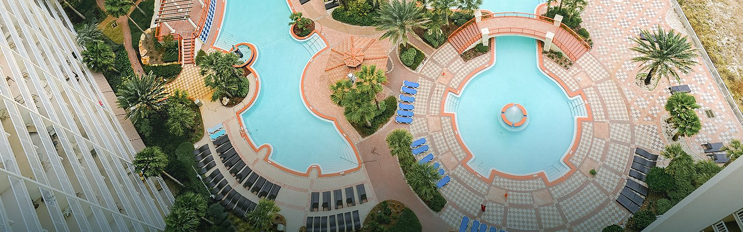 Aerial view of pool with palm trees