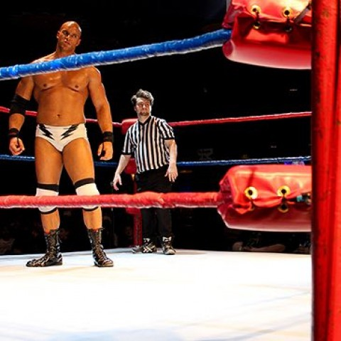 man and referee in a wrestling ring
