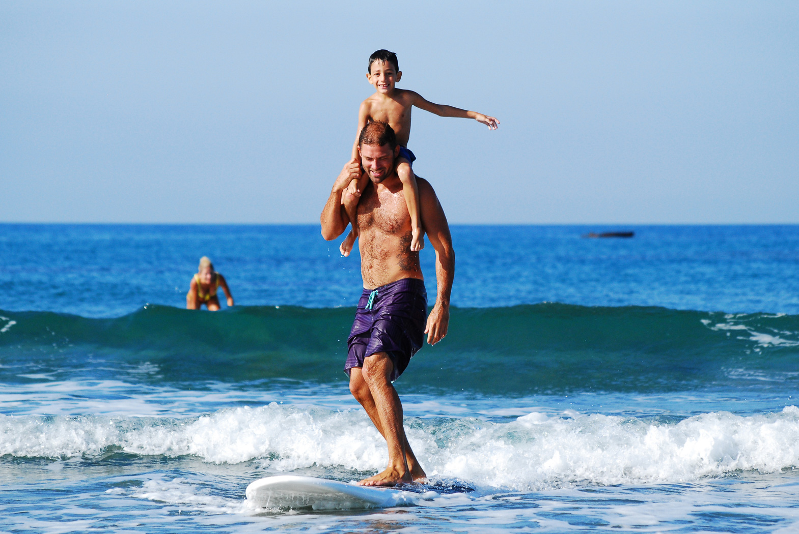 Man and child surfing