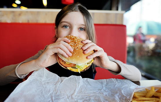 Child eating hamburger