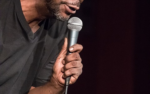 Stand Up Comedian with Microphone