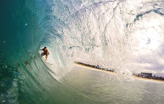 Surfer in the barrel of a wave