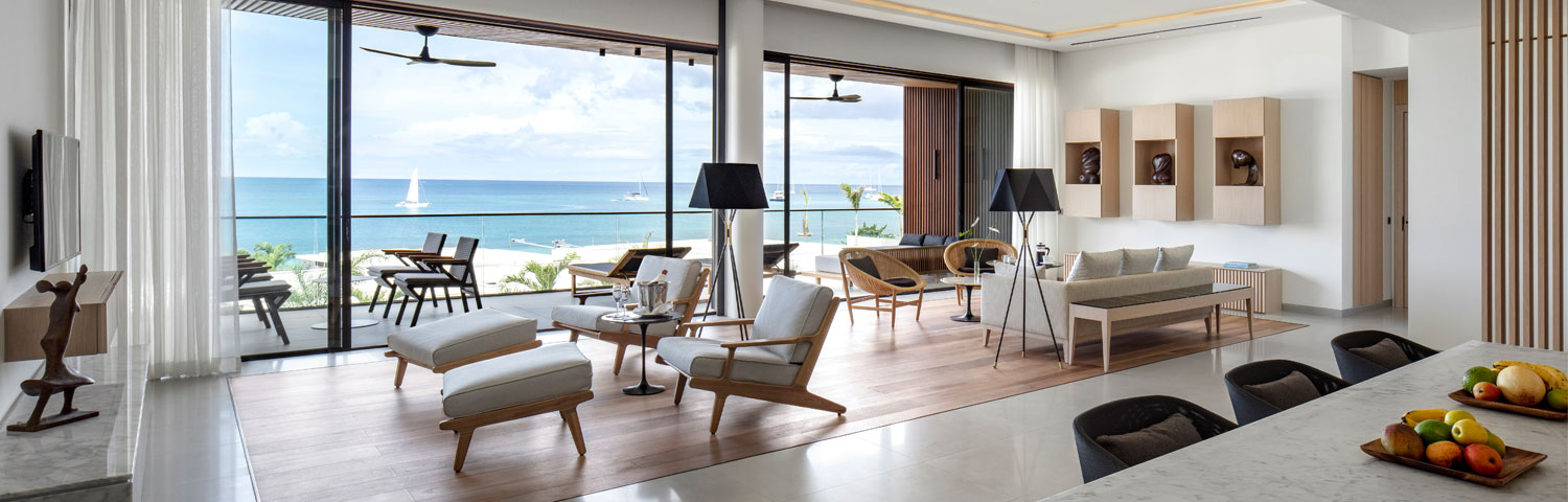 penthouse suite living and dining area looking out over ocean hero image