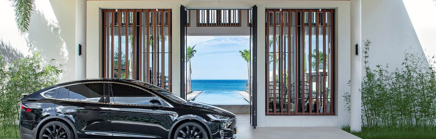 tesla pulling up to Silversands Grenada entrance