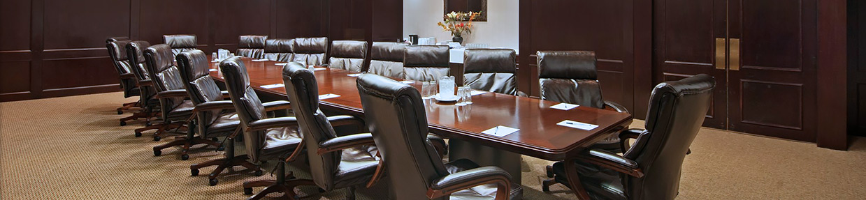 a conference room with a long table and chairs